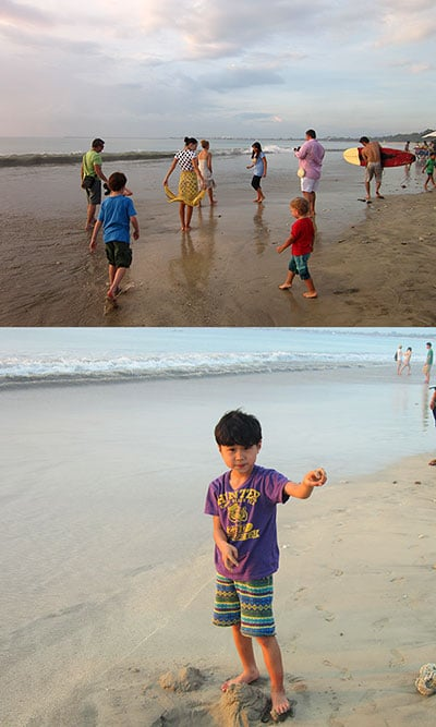 family travelers enjoy Jimbaran beach Bali with their kids